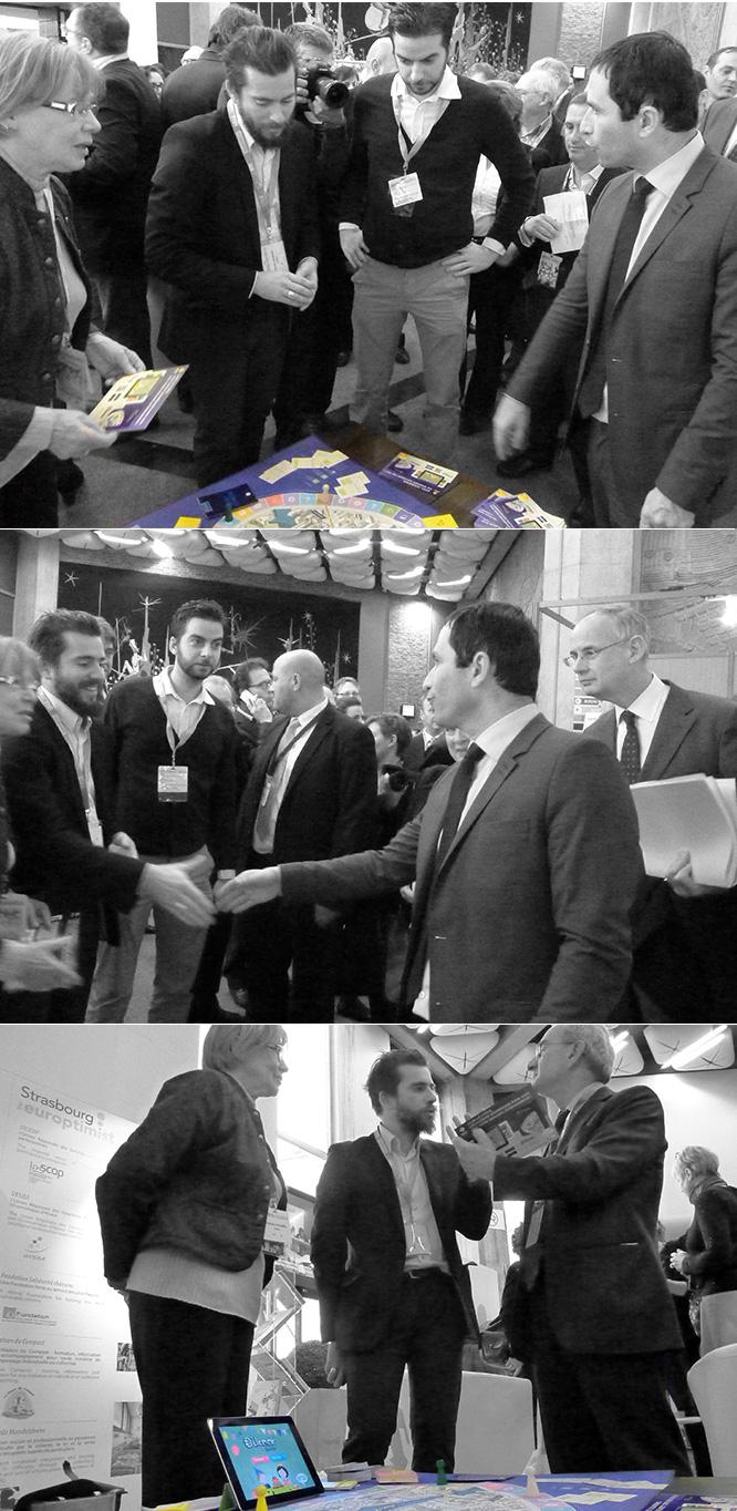 Crésus et Teekila présents au salon Strasbourg Europtimist pour présenter les jeux Dilemme et Dilemme Junior, ici  à Benoît Hamon et Catherine Trautmann